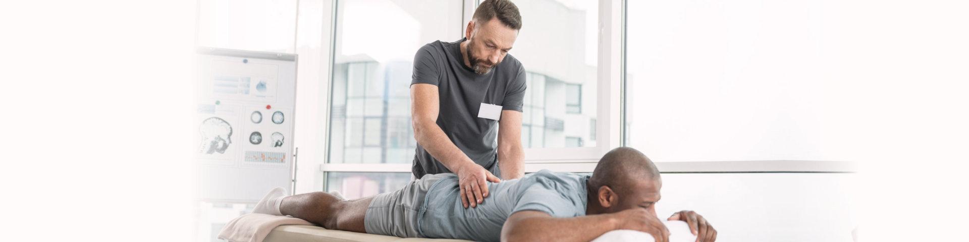 therapists massagin the man